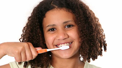 Photo of a child brushing their teeth