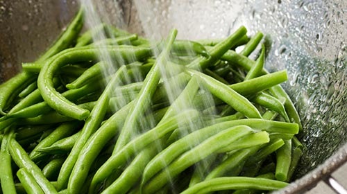 Photo of green beans being washed