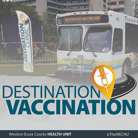 Destination Vaccination - photograph of bus next to banner