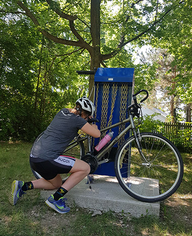 Photo of a cyclist using the CWATS repair station