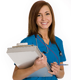 Woman wearing scrubs and a stethoscope holding a clipboard.