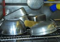 A picture of the dishes laying on a large drying rack.