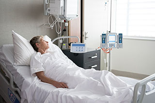 Photo of woman in hospital bed