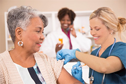 Photo of elderly woman getting flu shot