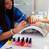 Photo of woman getting a manicure