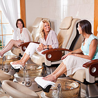 Photo of group of woman getting pedicure