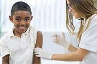 Photo of child receiving immunization shot