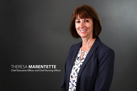 Photo of Theresa Marentette with titles - click for full resolution downloads