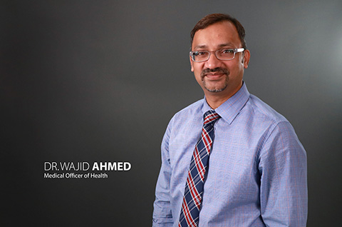 Photo of Wajid Ahmed with titles - click for full resolution downloads