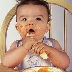 Photo of infant eating