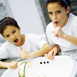 Photo of kids brushing their teeth