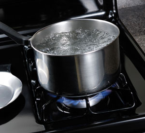 Water boiling on a gas stove