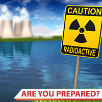 Photo of a nuclear power plant and radioactive warning sign