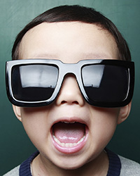 Photo of child in sunglasses